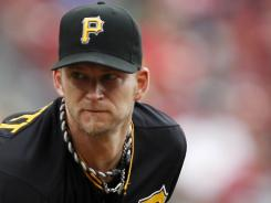 Pirates starting pitcher A.J. Burnett baffled the Reds, allowing just one hit after the first inning in 8 2/3 innings of work.