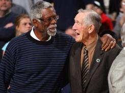 Arnie Risen, right, speaks with Bill Russell during at a ceremony on April 13, 2007 that honored the 50th anniversary of the 1957 Boston Celtics winning the NBA championship.