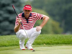 Keegan Bradley, with his unique style of reading the green, came up with a big par on the 18th hole Sunday after a plugged lie in a greenside bunker and edged Jim Furyk and Steve Stricker by one stroke to win the WGC-Bridgestone Invitational in Akron, Ohio. Bradley now heads to the PGA Championship, which he won a year ago.