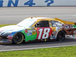 Kyle Busch heads to the pits after blowing a tire during Sunday's Pennsylvania 400 at Pocono Raceway.