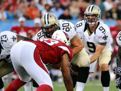 Saints quarterback Drew Brees (9) takes the snap during the first quarter of Sunday's Hall of Fame game against the Cardinals
