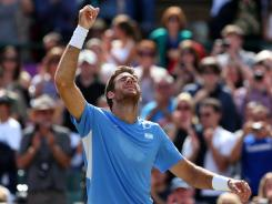 Argentina's Juan Martin Del Potro celebrates after defeating Novak Djokovic of Serbia to win the bronze medal in men's singles at Wimbledon.