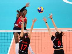 Destinee Hooker spikes the ball in the USA's final game of pool play.