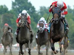 Fort Larned, right, wins The Whitney at Saratoga Race Course on Saturday.