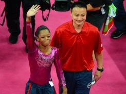 Gabrielle Douglas, left, with coach Liang Chow during her gold medal-winning performance in the all-around, has a chance to win two more gold medals in uneven bars and balance beam.