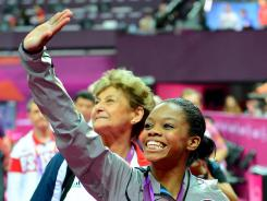 Gabby Douglas waves to the crowd after receiving her gold medal for winning the women's individual all-around competition. She says critics should focus on that accomplishment  not her hairstyle.