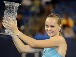 Magdalena Rybarikova poses with the trophy after beating Anastasia Pavlyuchenkova in the women's final of the Citi Open.