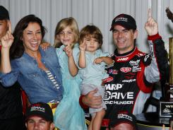 Jeff Gordon celebrates in victory lane with wife Ingrid Vandebosch, daughter Ella and son Leo after a rain-shortened win in the Pennsylvania 400.