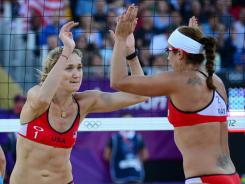 Kerri Walsh, left, and Misty May-Treanor are one win away from playing for their third consecutive gold medal.
