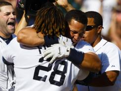 Miguel Cabrera gets a bear hug from Prince Fielder after Cabrera's game-winning two-run homer in the 10th inning.