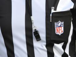 The whistle and uniform of NFL replacement referee Rusty Spindel before the preseason game between the Arizona Cardinals and the New Orleans Saints at Fawcett Stadium.