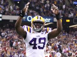 "Says LSU defensive end Barkevious Mingo of the extra phrase on the side of the SEC title rings, ""I guess coach thought it would be a good idea. Uh  hellip> /hellip> but  hellip> /hellip> um (long pause), it is what it is."""
