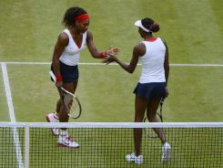 Serena Williams and Venus Williams of the USA claim their third gold medal in doubles with a victory Sunday against Andrea Hlavackova and Lucie Hradeka of the Czech Republic.