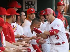 Carlos Beltran receives congratulations from teammates in the dugout after hitting a lead-off home run in the second inning Monday night against the Giants.
