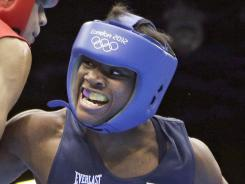 The USA's Claressa Shields defeated Sweden's Anna Laurell in her first bout Monday and is guaranteed of a medal.