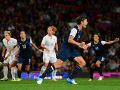 U.S. forward Abby Wambach celebrates after scoring a goal on a penalty kick.