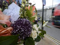 Bouquets and notes are left near the spot where British cyclist Daniel Harris was killed last week.