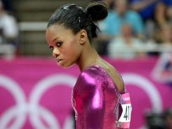 Gabby Douglas, pictured here during last week's all-around competition, faltered on the uneven bars on Monday and missed out on a medal.