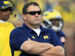 Michigan coach Brady Hoke hasn't decided when his two suspended players will return to the team.
