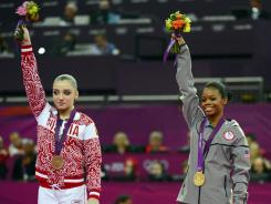 Falling short: Russia's Aliya Mustafina, left, settled for bronze in women's gymnastics individual all-around while the USA's Gabby Douglas won gold.
