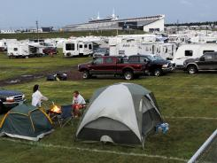 The scene in a parking lot near the Pocono Raceway grandstands following Sunday's NASCAR Sprint Cup race. Lightning strikes after the race was called killed one man and hospitalized nine others.