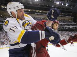 Nashville Predators defenseman Hal Gill battles for position with the Phoenix Coyotes' Taylor Pyatt during the playoffs.