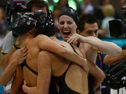 USA swimmer Missy Franklin, right, celebrates with her teammates as they win the gold medal setting a new world record at 3:52.05 in the women's 4x100m medley relay final during the London 2012 Olympic Games at the Aquatics Centre.