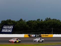 Jeff Gordon leads laps under caution Sunday at Pocono Raceway as a severe thunderstorm approaches.