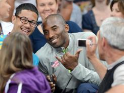 "U.S. basketball star Kobe Bryant, attending a women's volleyball match July 30, can't explain his popularity. ""I have a hard time putting my finger on it,"" he says."