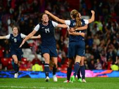 U.S. forward (13) Alex Morgan celebrates with teammates after scoring the winning goal in extra time against Canada in the women's soccer semifinals Monday at Old Trafford.