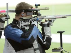 Matthew Emmons of the USA lines up a shot on his way to a bronze medal in the 50-meter rifle three position event Monday.