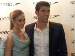After finishing up his Olympic career, Michael Phelps was seen with girlfriend Megan Rossee on the red carpet at a Speedo event in London.