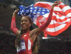 Sanya Richards-Ross celebrates after winning the women's 400 meters Sunday at Olympic Stadium in London, giving the USA its first track and field gold of the Games.