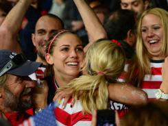 U.S. forward Alex Morgan, center, celebrates in the crowd Monday after scoring the winning goal in a semifinal vs. Canada.