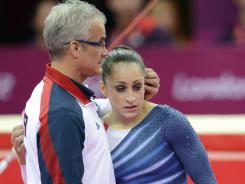 London, United Kingdom; Jordyn Wieber (USA), right, gets a hug from coach John Geddert (left) after competing in the women's floor exercise final during the 2012 London Olympic Games at North Greenwich Arena.