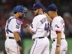 Catcher Geovany Soto, left, and pitcher Ryan Dempster, talking Aug. 2 with Rangers pitching coach Mike Maddux, were among the few contributors to switch leagues.