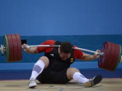 Germany's Matthias Steiner fails to lift 196 kilograms (432 pounds) in the men's super heavyweight competition.