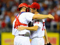 Catcher Erik Kratz congratulates starting pitcher Cole Hamels after the lefty shut out the Braves 3-0.