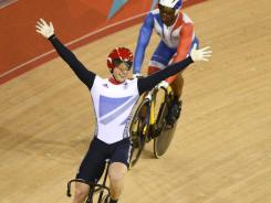 Great Britain cyclist Jason Kenny basks in the joy of victory Monday in the individual pursuit, another event that provided excitement for the home fans.