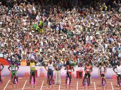 Fans cheer during a men's 100-meter heat. Most countries represented at the Games have London residents with ties to that nation.