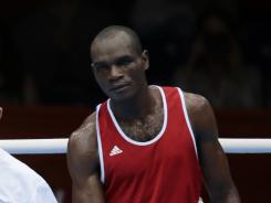 Cameroon's Christian Donfack Adjoufack shown after his boxing match against Germany's Enrico Kolling, was one of seven Cameroon athletes named by his country as having gone missing from the Olympic Village.