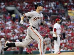 Buster Posey rounds the bases after hitting a three-run home run off Cardinals starting pitcher Lance Lynn in the first inning Tuesday night.