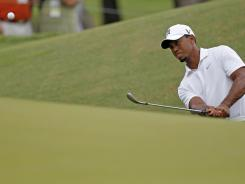 Tiger Woods watches his chip to the ninth green during a practice round Tuesday for the PGA Championship on the Ocean Course at Kiawah Island, S.C.