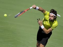 France's Jeremy Chardy serves against Donald Young, of the United States at the Rogers Cup tennis tournament in Toronto.