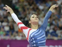 Alexandra Raisman (USA) reacts after competing in the women's balance beam final during the 2012 London Olympic Games at North Greenwich Arena. Raisman took bronze after a protest.
