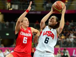 U.S. guard Sue Bird goes to the basket against Canada guard Shona Thorburn during the first half of their quarterfinal matchup.