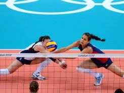The USA's Nicole Davis, left, and Logan Tom dive for a dig attempt during their quarterfinal victory against the Dominican Republic.