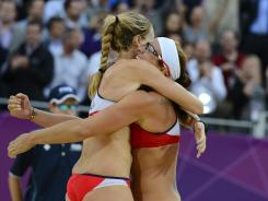Kerri Walsh and Misty May-Treanor celebrate after advancing to the women's beach volleyball gold medal match.