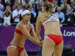 Misty May-Treanor, left, and Kerri Walsh Jennings play for their third consecutive gold medal on Wednseday, this time against fellow Americans April Ross and Jennifer Kessy.