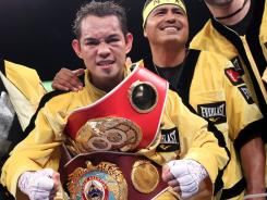Nonito Donaire and trainer Robert Garcia after Donaire won a 12-round unanimous decision against IBF champion Jeffery Mathebula in July.